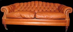 Salon Glastonne comprenant 1 canapé 3 places + 1 fauteuil + 1 pouf en cuir de vachette coloris gold